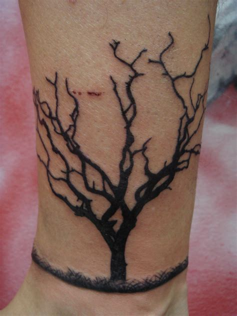 tree branch tattoo designs dead tree tattoos designs ideas and meaning tattoos for you