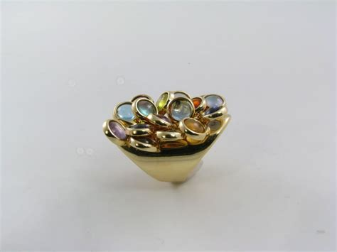 a fabulous yellow gold and colored ring at 1stdibs
