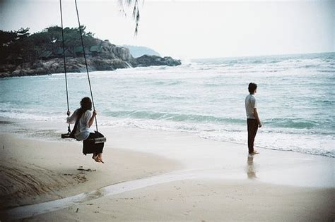 swing on the beach beach couple sea swing image 274242 on favim com