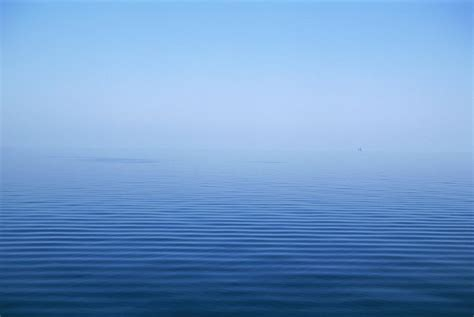 calming blue calm blue water disappearing into photograph by axiom