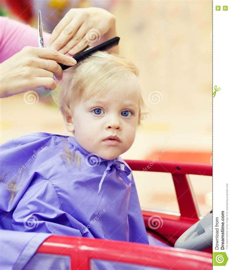 first time haircut for little boy with curly hair first haircut of little boy stock image image 73605835