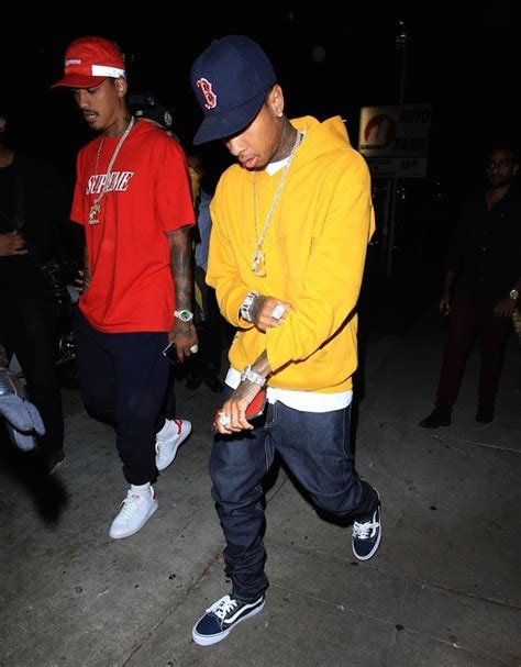 tyga yellow spotted tyga steps out his red ferrari in gosha