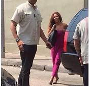 Beyonc&233 Dons Pink Jumpsuit While Jay Z Cradles Daughter