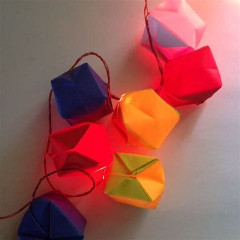 Origami Paper Balloon - make pretty origami balloon lights via guidecentral do