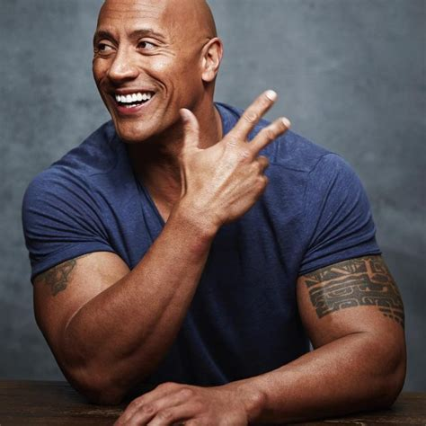 dwayne johnson getting tattoo dwayne johnson tattoos full guide and meanings 2018