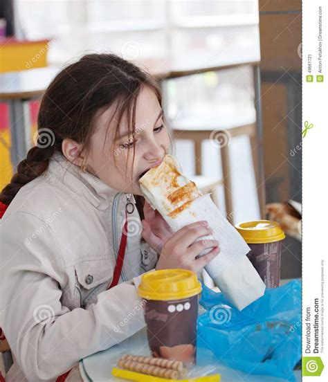 female hot dog eating chion girl eating a hot dog in a cafe stock image image 49661721