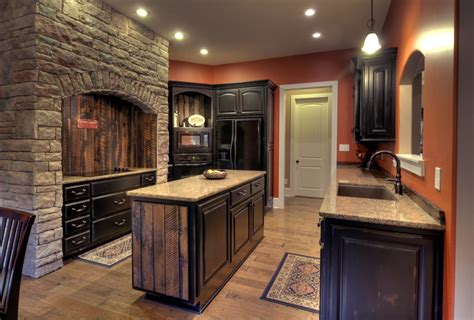 creating distressed wood cabinets only with paint and wax how to distress dark wood cabinets digitalstudiosweb com