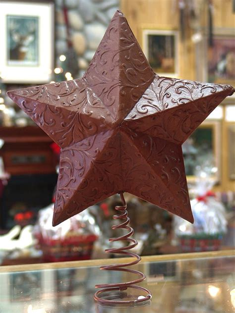 western leather embossed christmas star tree topper