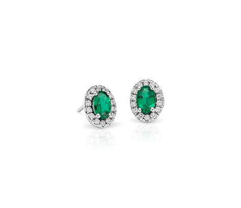 emerald and pav 233 halo earrings in 18k white gold