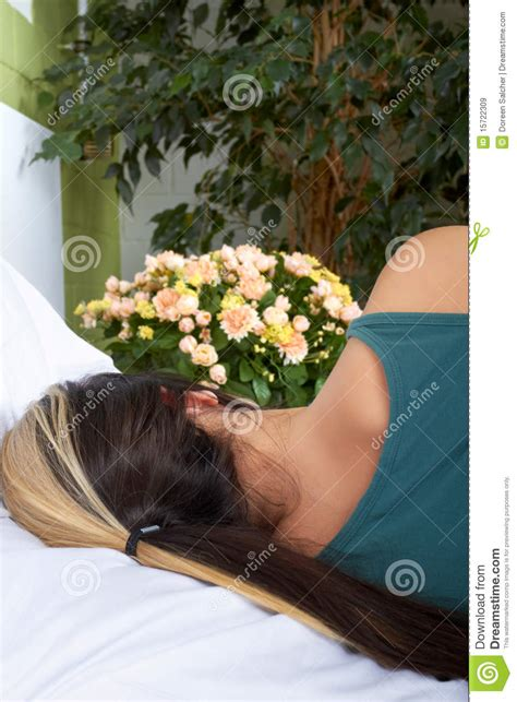girl lying bed with flowers woman in bed with flowers royalty free stock images