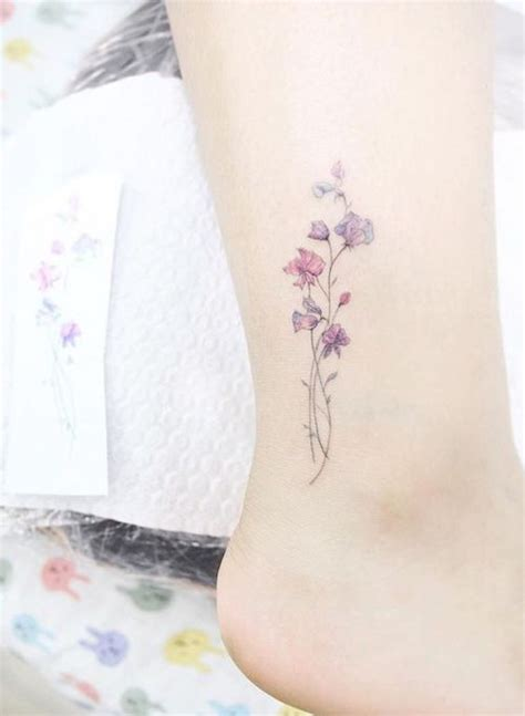 violet tattoo on wrist 26 tiny floral tattoos that are too pretty for words she
