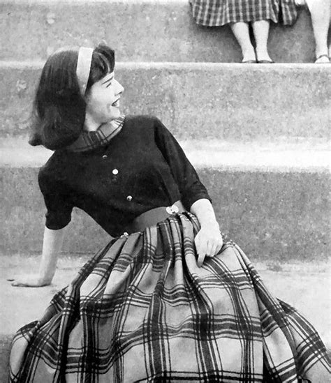 hairdo of teens in the 50s girl in blouse and plaid skirt 1958 vintage 1950s