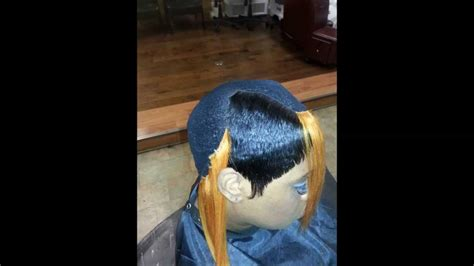 27 piece long on one side 27 piece quickweave cap weave boy bob long