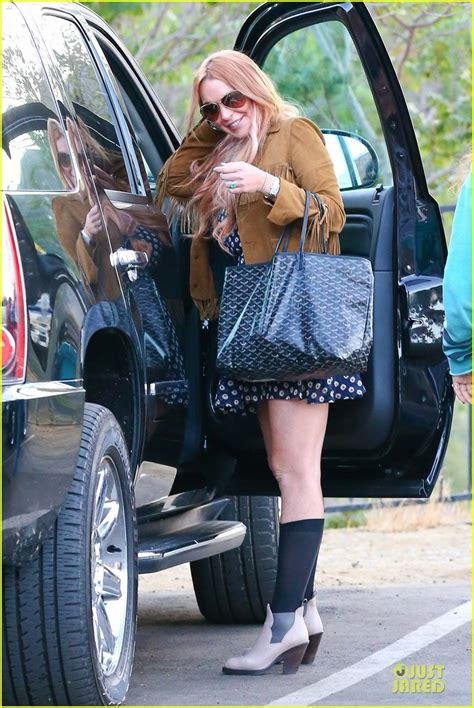 Lohan Leaves Rehab To Attend Aa Meeting Gets Mobbed By Paparazzi by Lindsay Lohan Released From Rehab Smiles While Leaving
