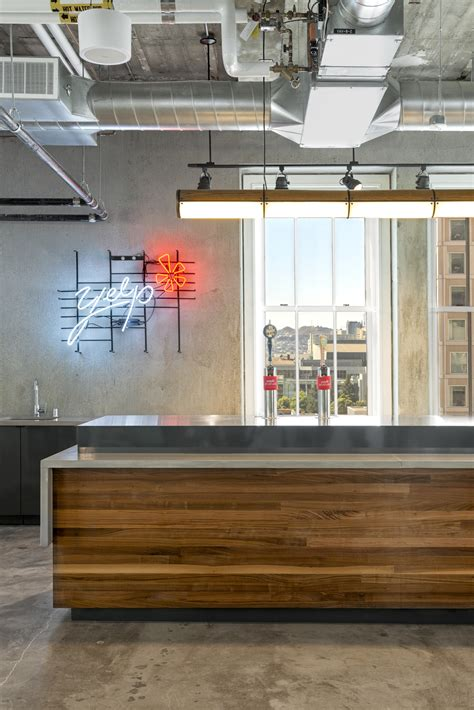 Exposed Brick Walls & Concrete Define The New Yelp