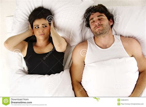snoring keeping awake in bed stock photos
