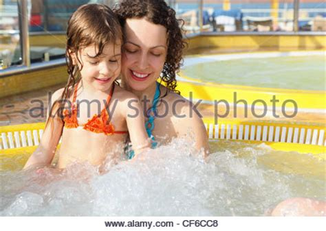 daughter in bathtub swimming pool deck on cruise ship msc poesia stock photo