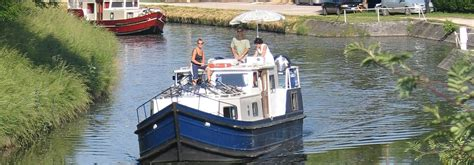 small boat kept on large boat canal boat holidays in france 2017 midi and burgundy