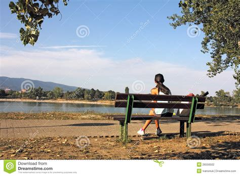 bench girl girl on bench stock photography image 26556502
