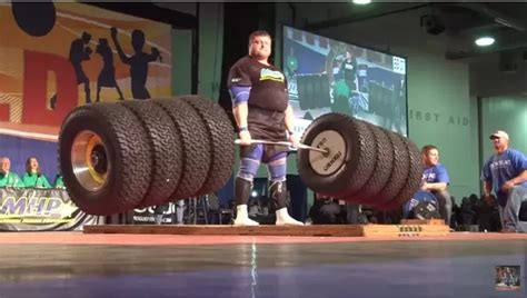 what is the most weight ever benched what is the heaviest weight ever lifted by a human being