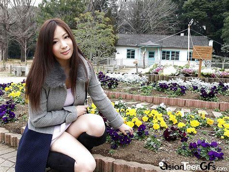 cute asian teen poses at outdoor