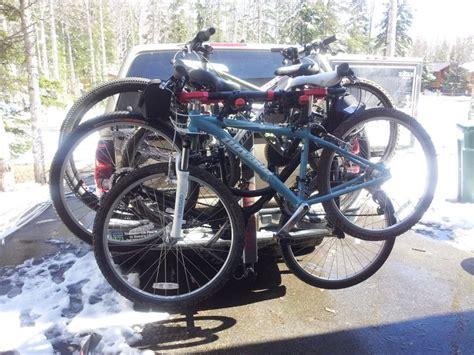 how to load bikes on bike rack yakima swing daddy 4 bike rack with women s 29er and kids bikes mtbr com