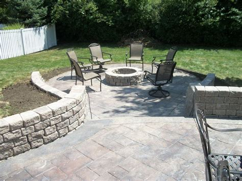 sted concrete patio with retaining walls and pit