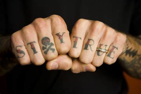 finger tattoos words 60 word tattoos on fingers