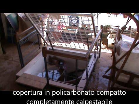 botole per terrazzi lucernario elettrico in policarbonato su misura