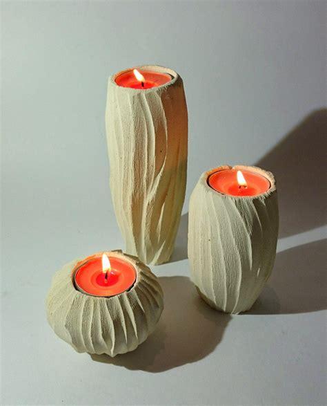 candele scolpite tris di porta candele in pietra leccese linea madrepora