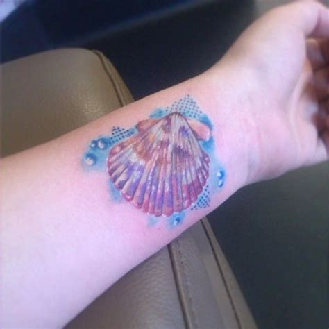 15 dashing seashell wrist tattoos