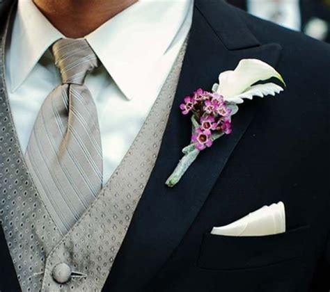 fiore all occhiello significato boutonniere per lo sposo per i testimoni e per i pap degli