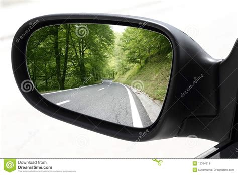 rearview car driving mirror view forest road stock image
