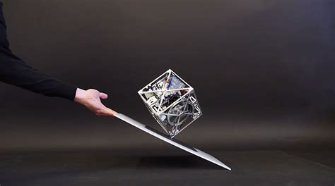 Balance Cube the cubli a gravity defying cube that can jump balance and walk colossal