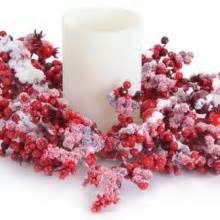 candle ring snow red berries snowflake and pine cone wreaths