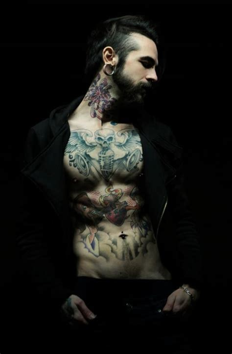 gothic tattoos for men dressed in black a sleek modern look paired with a