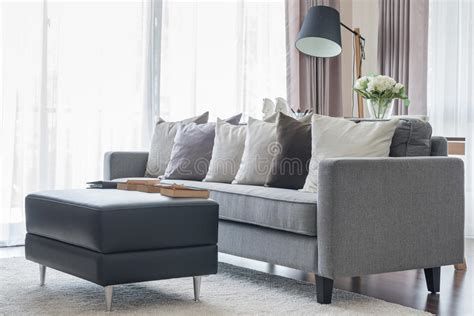 graues sofa modern grey sofa with pillows and black table in living
