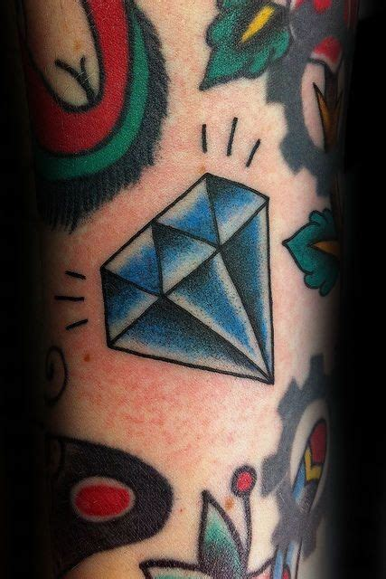 traditional diamond tattoo with small traditional on forearm