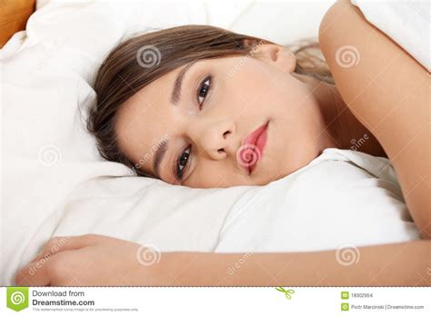 girls laying in bed young sad girl lying in bed stock images image 18302954