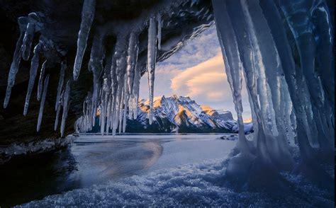 cave ice mountain winter sunrise snowy peak lake