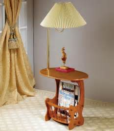 Warm oak finish oval end table with brass lamp and built in magazine
