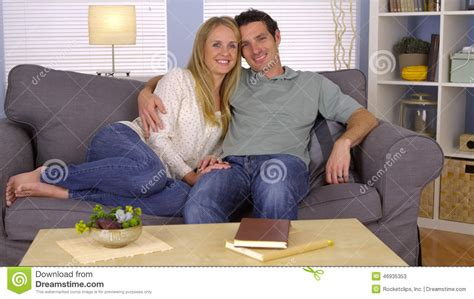 cuddling on the sofa couple cuddling on couch stock photo image 46935353