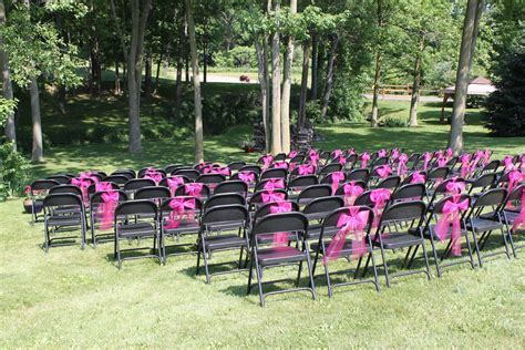 Ordinary folding chairs dressed up with hot pink tulle