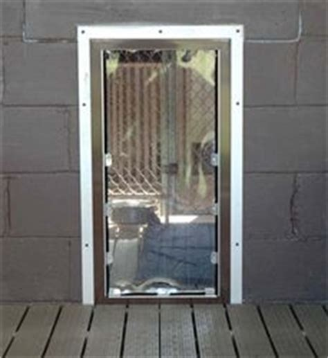 Exterior Door With Pet Door Installed 1000 Images About Kennel Doors On Pinterest Cable The Wall And Nylons