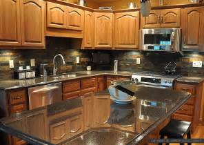 Brown cabinets slate backsplash tile black granite countertop