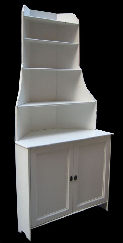 white wooden corner shelving unit with drawer for