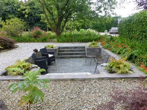 patio l sunken slate patio in a small garden stock photo