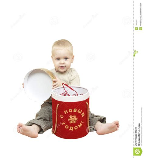 new year gift for child the small child opening box with a new year s gift