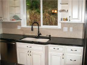 kitchen stove and tiled backsplash with built in