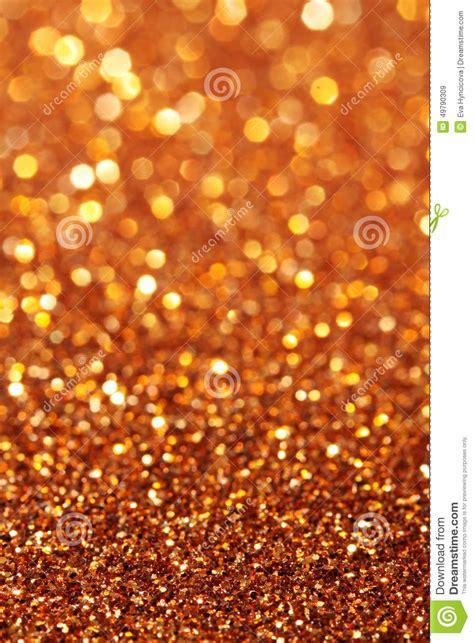 z glitter copper bronze gold mix texture glitter soft lights yellow orange gold background stock image